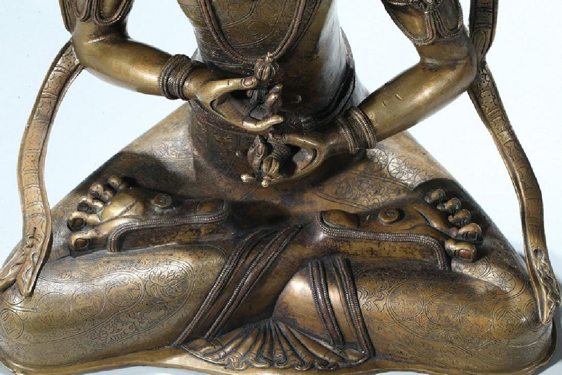 A COPPER AND SILVER INLAID COPPER ALLOY FIGURE OF - 4
