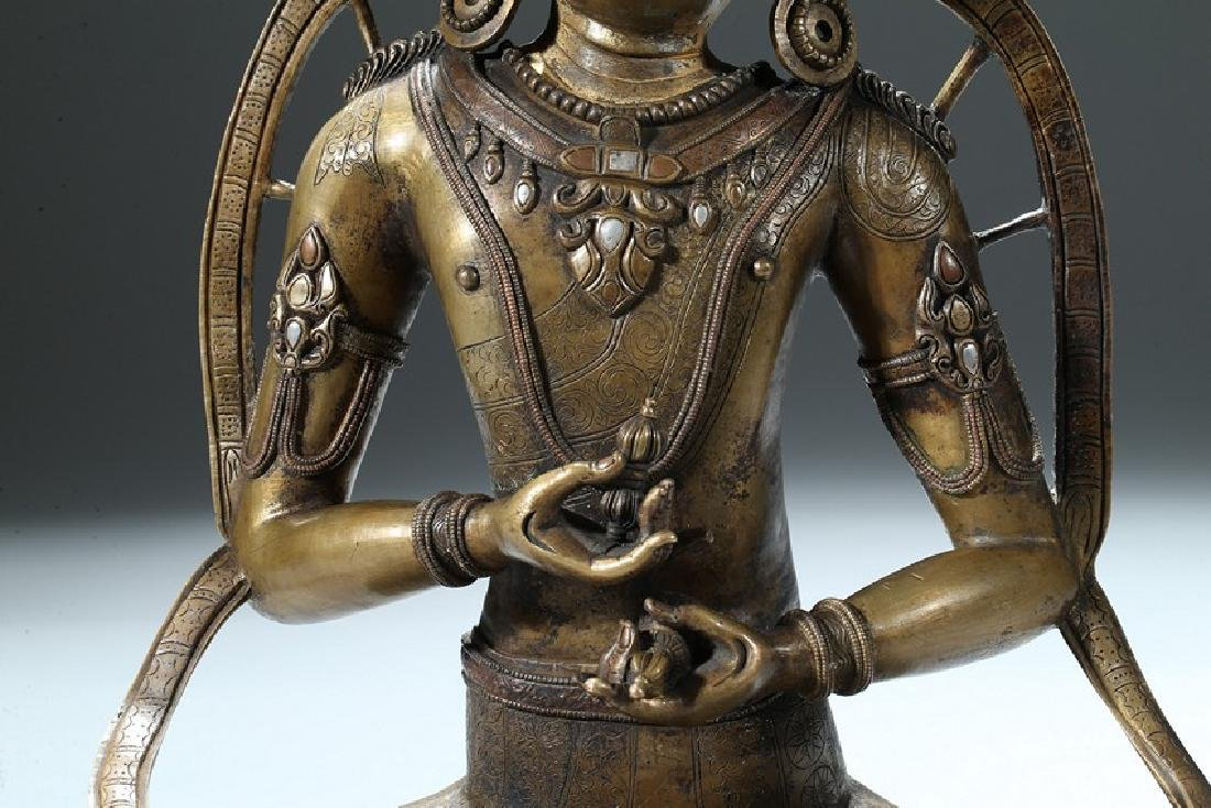 A COPPER AND SILVER INLAID COPPER ALLOY FIGURE OF - 8