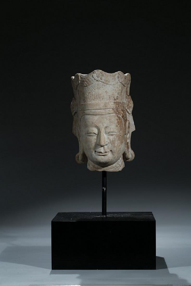 A LIMESTONE CARVED HEAD OF BODHISATTVA