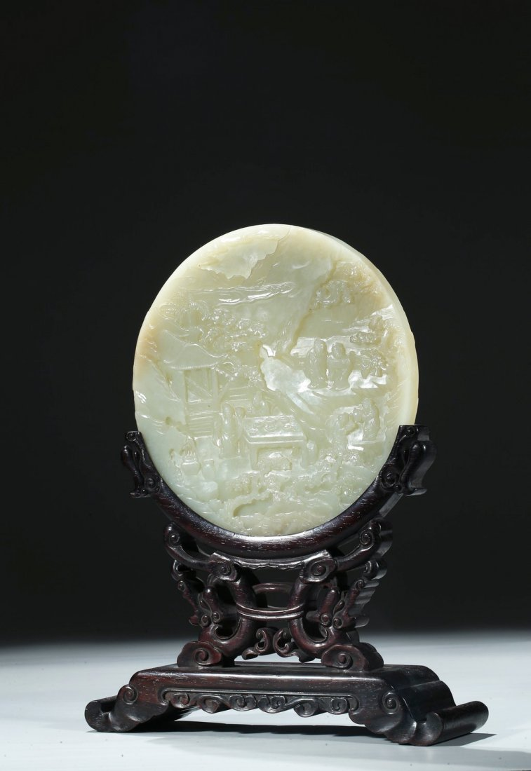 A WHITE JADE TWO SIDE 'SAGES AND BOAT' CIRCULAR TABLE