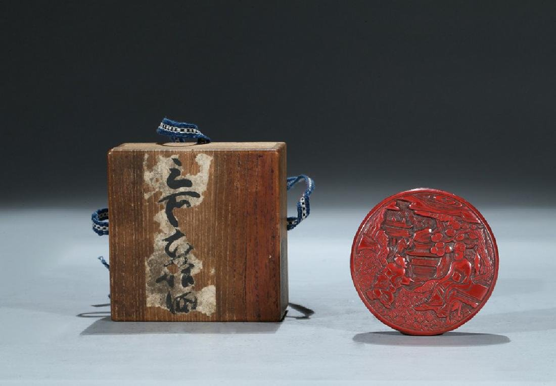 A CINNABAR LACQUER 'FIGURES' CIRCULAR BOX AND COVER