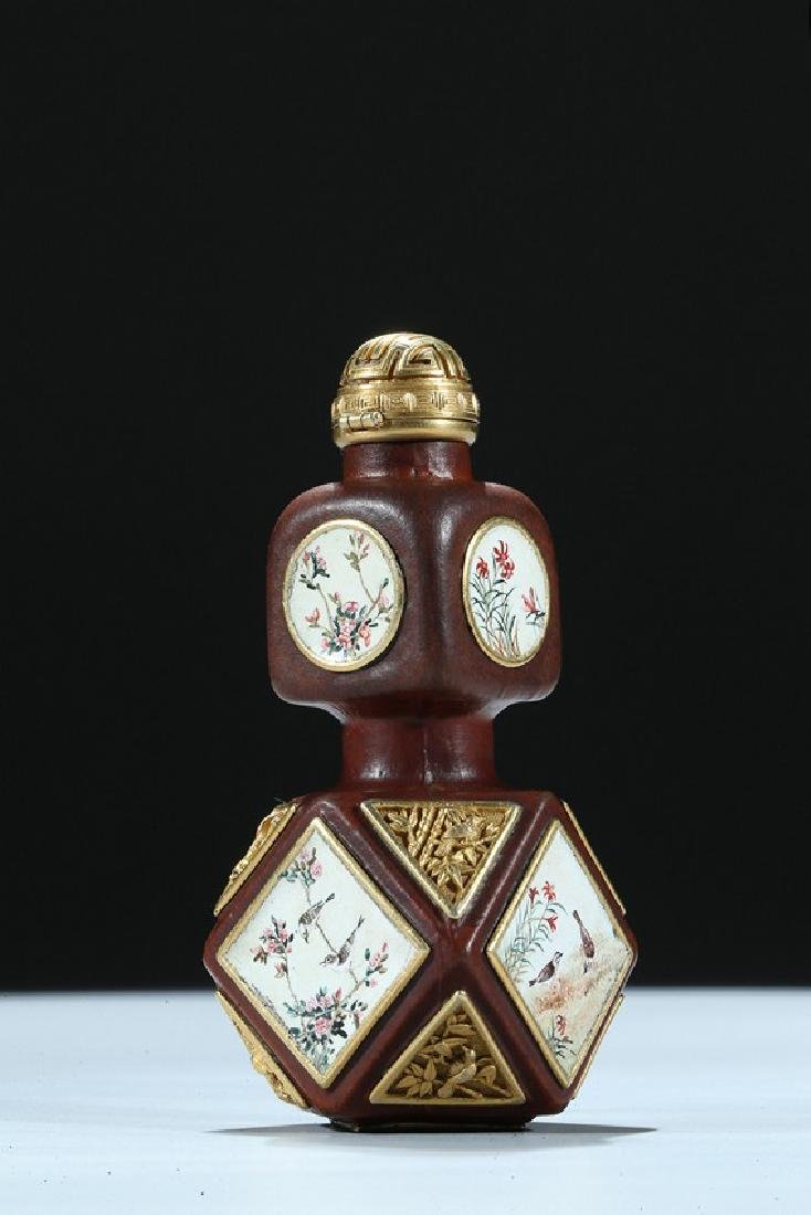 A FACETED MOULDED GOURD ENAMELLED AND GILT SNUFF BOTTLE