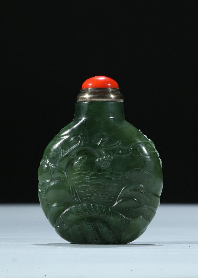 A CHINESE SPINACH GREEN JADE 'DEER' SNUFF BOTTLE