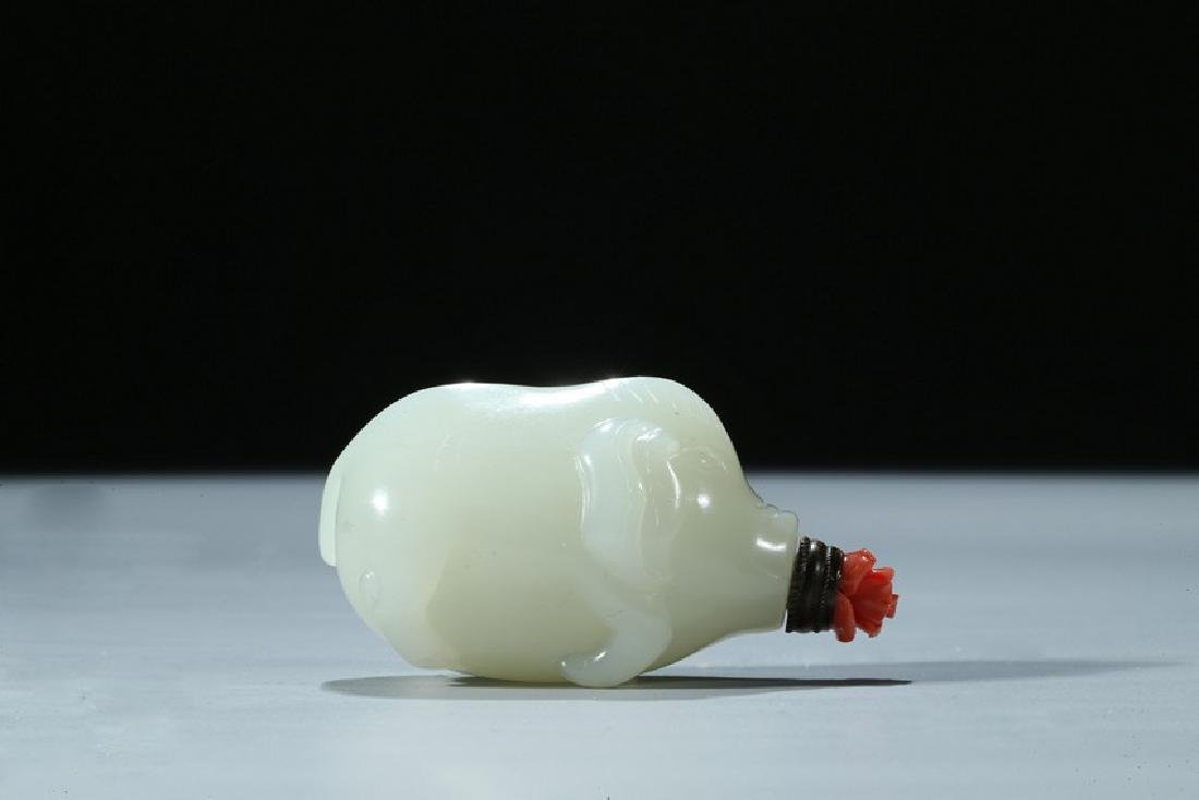 A CHINESE WHITE JADE 'PIG' SNUFF BOTTLE