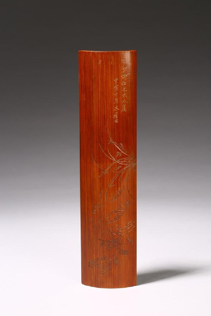 A CARVED BAMBOO INSCRIBED WRISTREST WITH INSCRIPTION