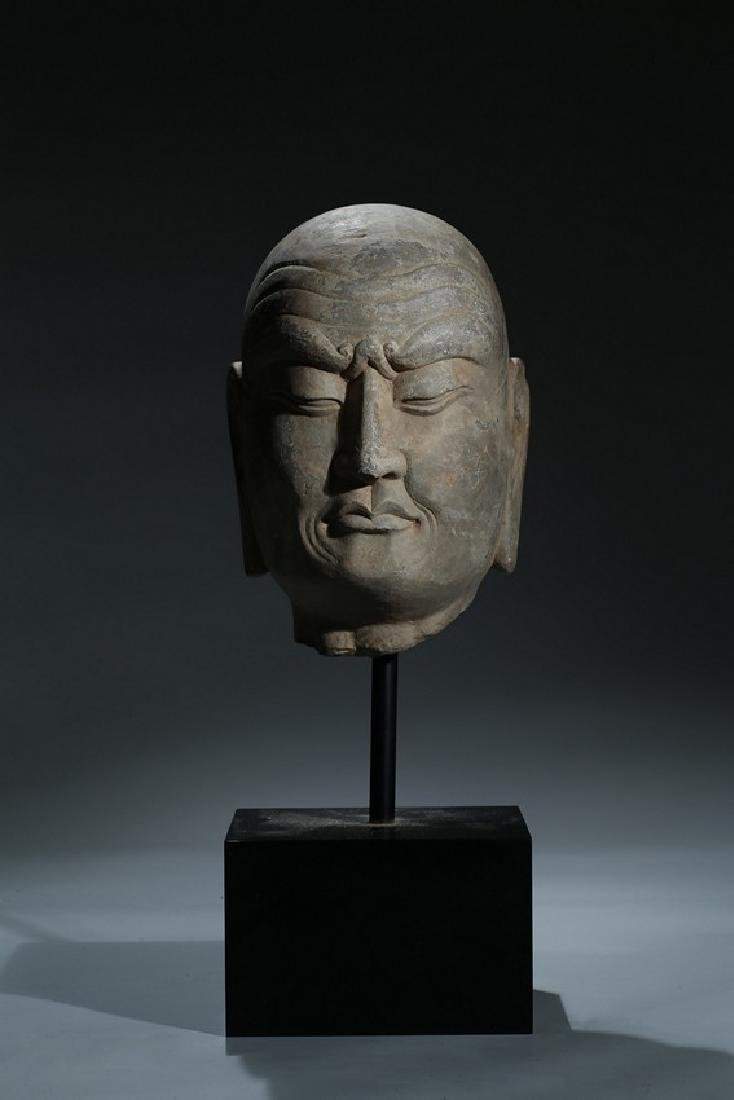 A CHINESE LIMESTONE CARVED HEAD OF LUOHAN
