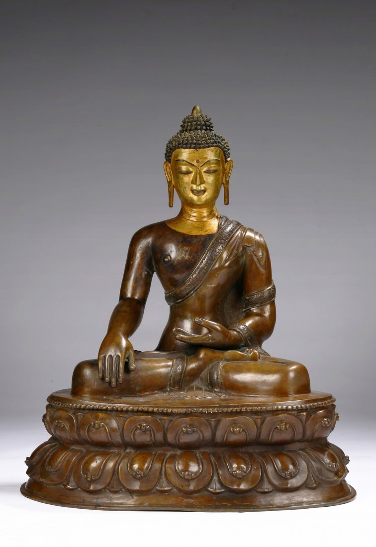 A VERY LARGE TIBETAN COPPER ALLOY FIGURE OF SHAKYAMUNI