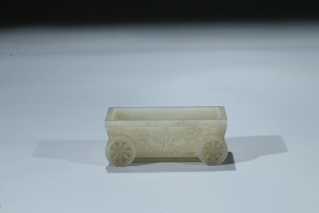 A CELADON JADE CARVED 'TAOTIE' CART-FORM COLLECTOR'S