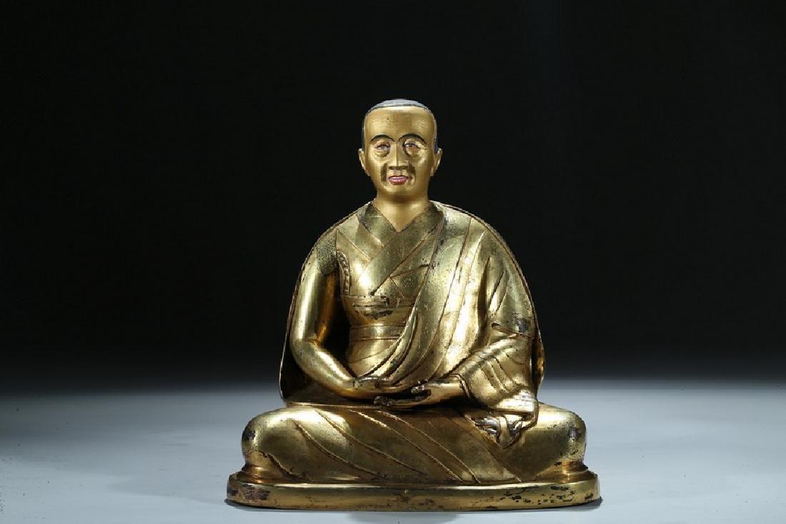 A GILT BRONZE FIGURE OF LAMA WITH INSCRIPTION - 2