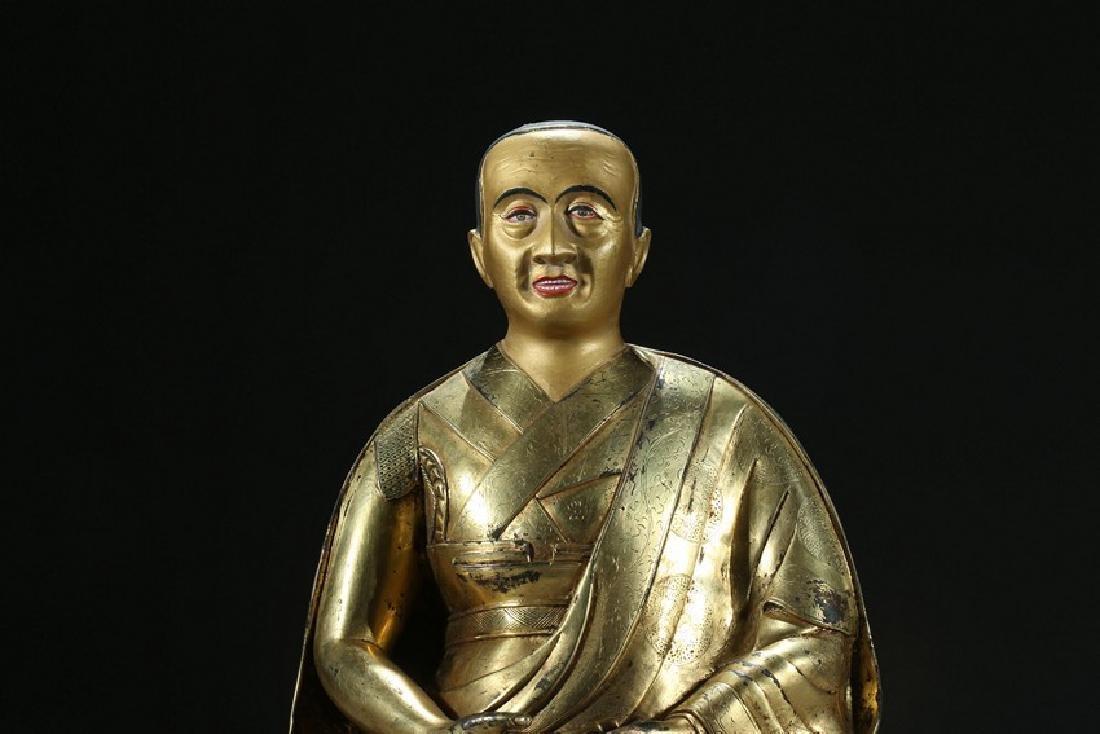 A GILT BRONZE FIGURE OF LAMA WITH INSCRIPTION - 3