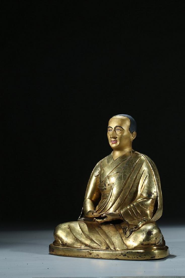 A GILT BRONZE FIGURE OF LAMA WITH INSCRIPTION - 6
