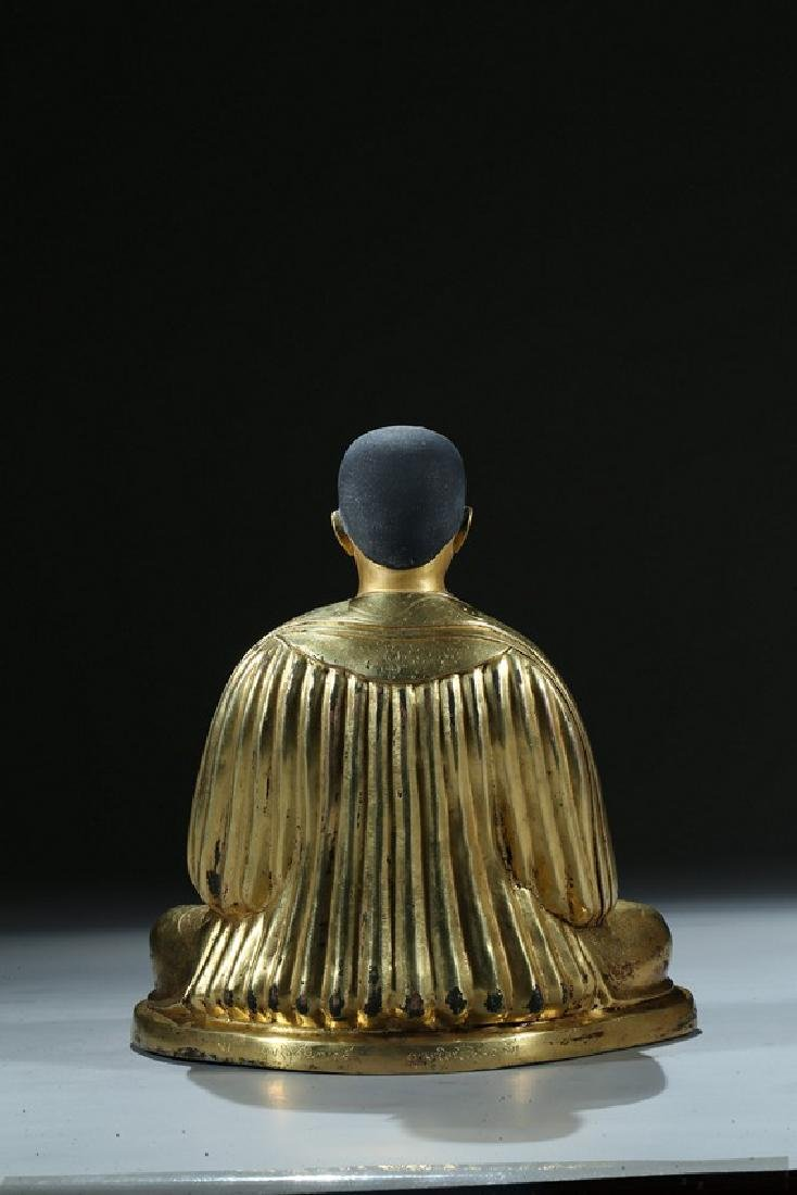 A GILT BRONZE FIGURE OF LAMA WITH INSCRIPTION - 8