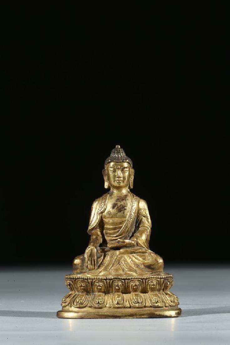 A GILT BRONZE FIGURE OF SEATED BUDDHA