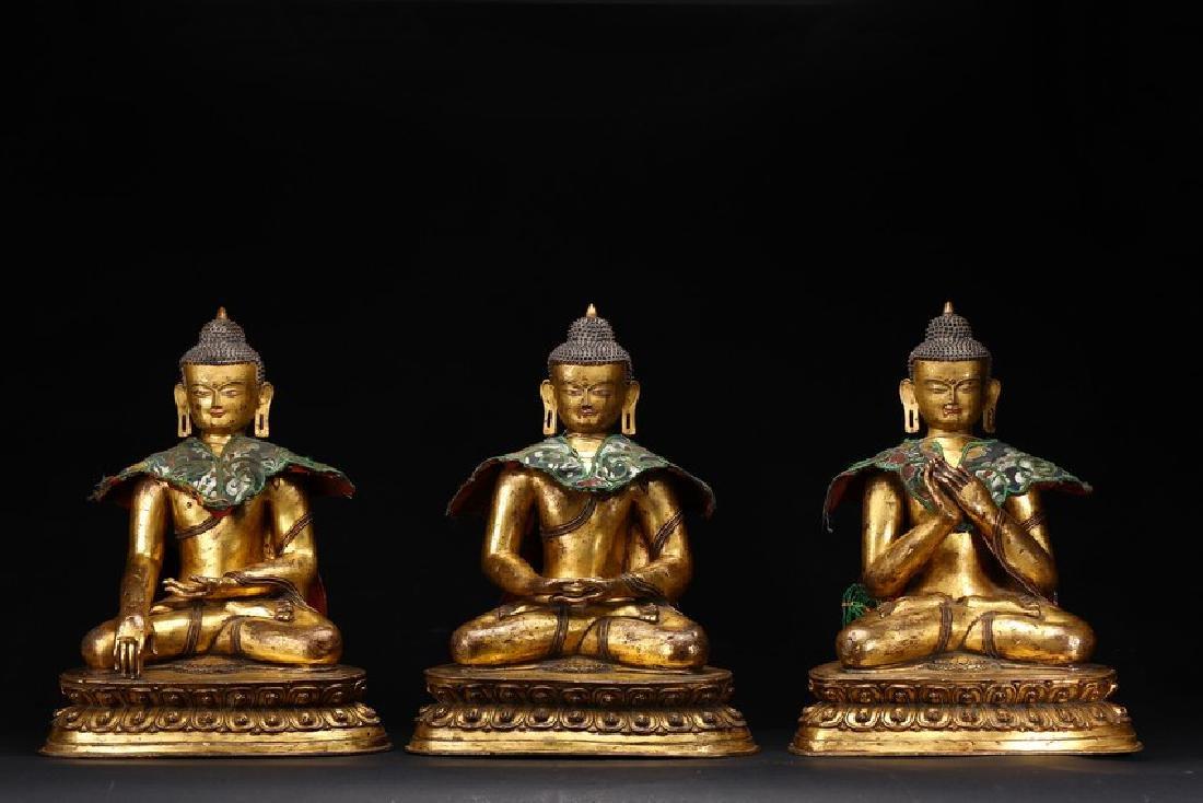 A SET OF THREE GILT BRONZE BUDDHA STATUES