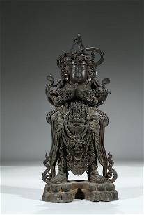 A LARGE BRONZE FIGURE OF STANDING WEITUO
