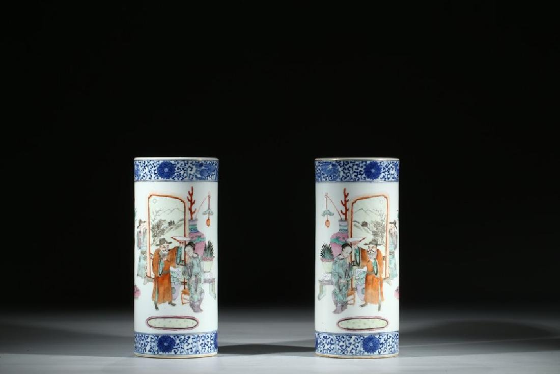 A PAIR OF FAMILLE ROSE 'FIGURES' HAT STANDS