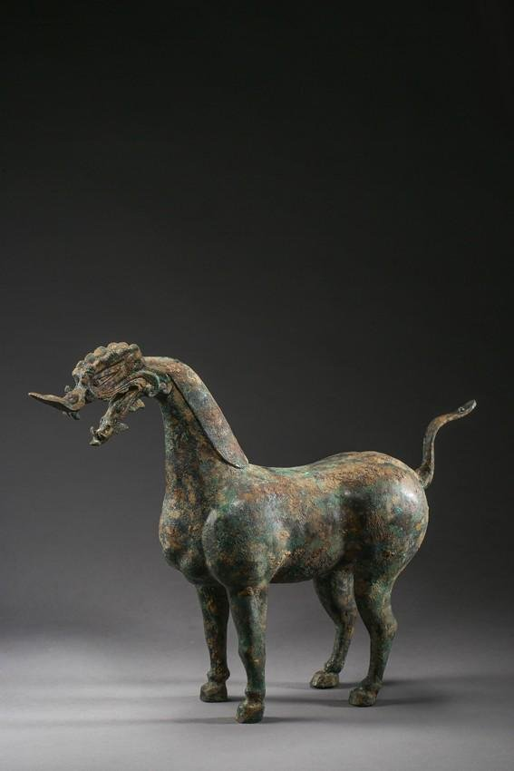 A CHINESE BRONZE CAST 'DRAGON-HEAD' HORSE