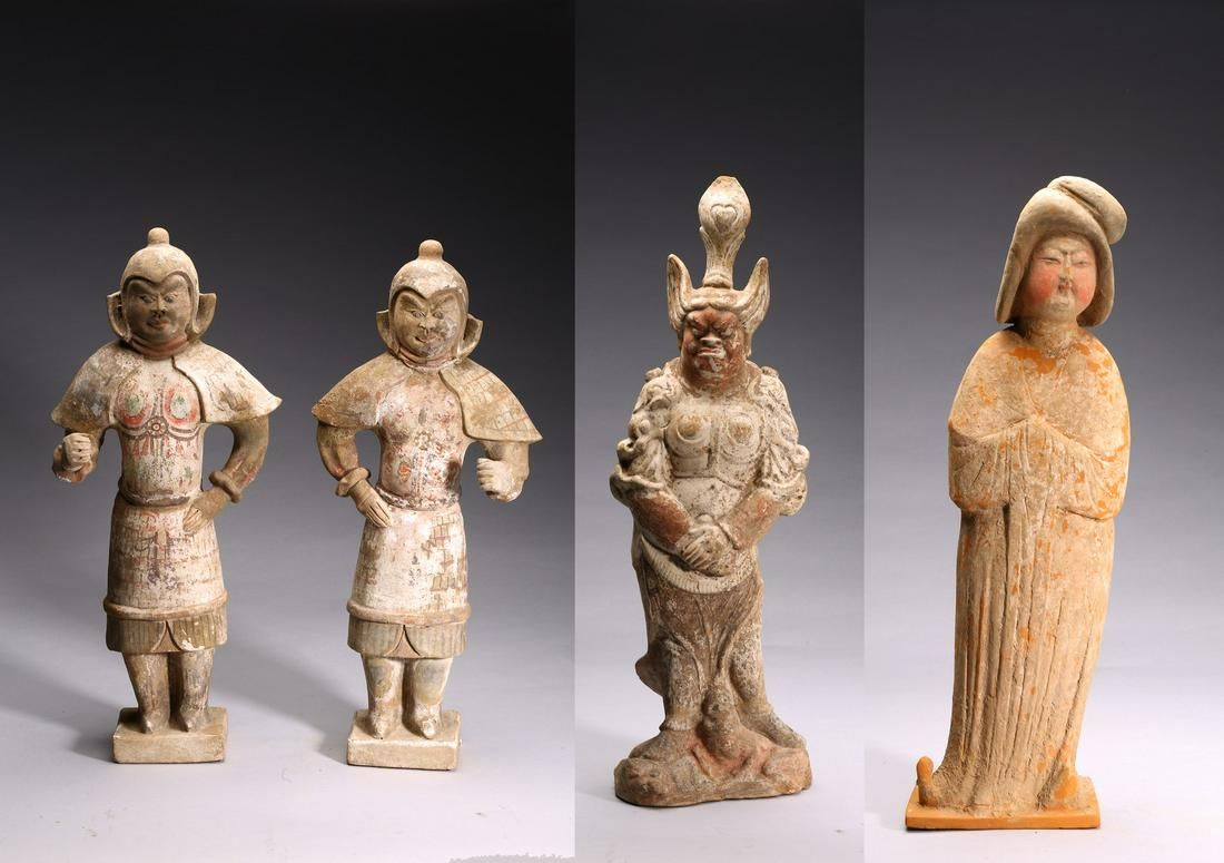 A SET OF FOUR PAINTED POTTERY FIGURES