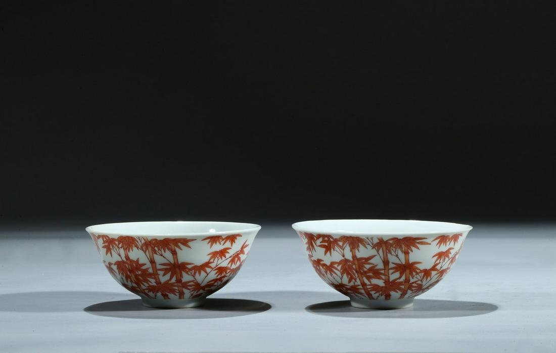 A PAIR OF IRON RED ENAMEL 'BAMBOO' BOWLS