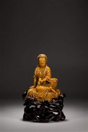 A CHINESE SOAPSTONE CARVING OF SEATED GUANYIN