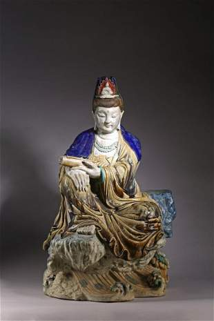 A LARGE CHINESE POLYCHROME GLAZED SEATED FIGURE OF