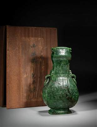 A LARGE CHINESE SPINACH GREEN JADE 'TAOTIE' HU VASE