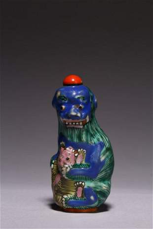 A FAMILLE ROSE 'BUDDHIST LIONS' SNUFF BOTTLE