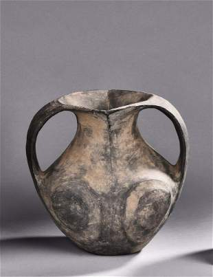 A TWO HANDLED POTTERY VASE