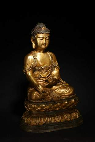A GILT BRONZE FIGURE OF SHAKYAMUNI