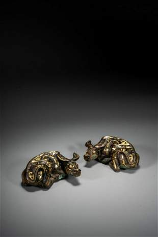 A PAIR OF BRONZE GOLD INLAID 'BUFFALO' PAPER WEIGHTS
