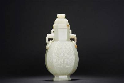 A CHINESE WHITE JADE 'TAOTIE' VASE WITH COVER