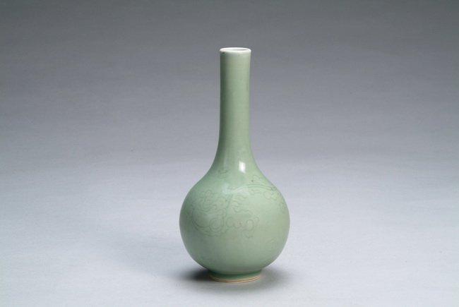 "11: A Chinese celadon glazed ""Dragon"" vase"