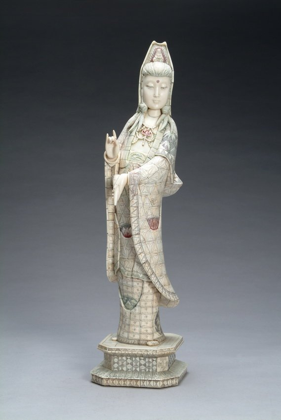 23: A Chinese bone carved Guan Yin figure