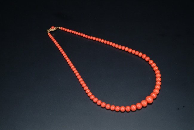 1: A RED CORAL NECKLACE