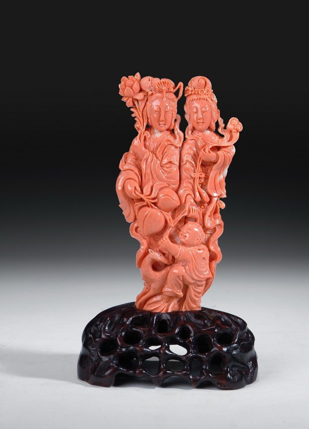 201: A CHINESE CARVED RED CORAL FIGURAL GROUP