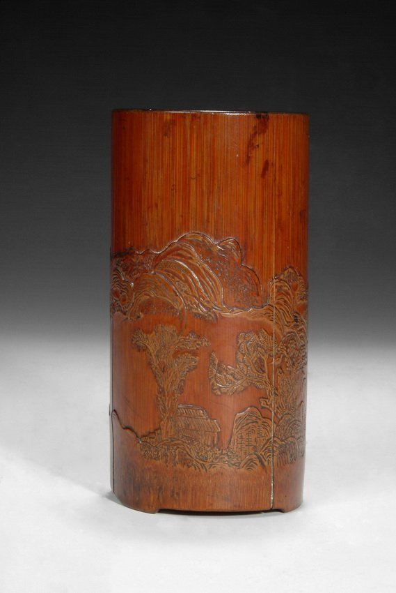 A WELL CARVED BAMBOO BRUSH POT