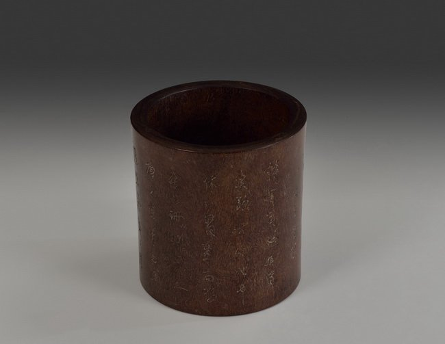 A ZITAN BRUSH POT CARVED WITH CALLIGRAPHY