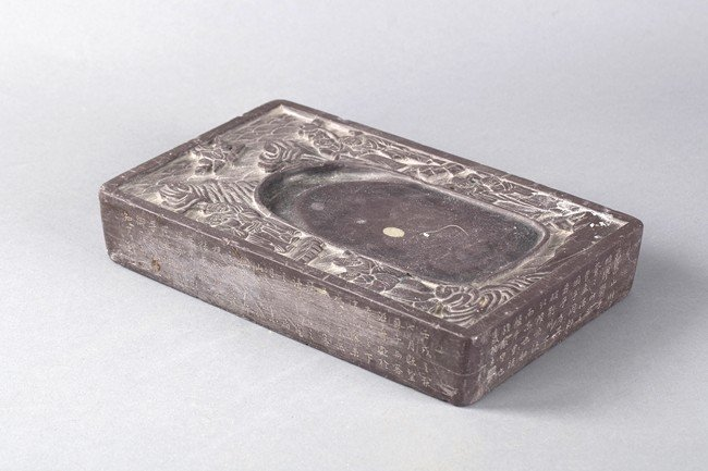 A CHINESE CALLIGRAPHY AND ELDER INKSTONE