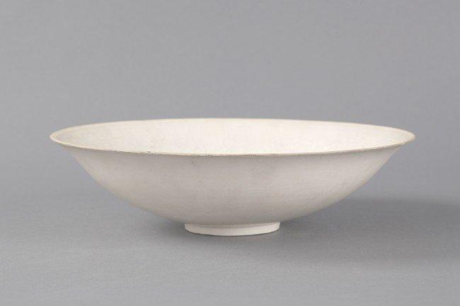 A WHITE GLAZED PORCELAIN BOWL