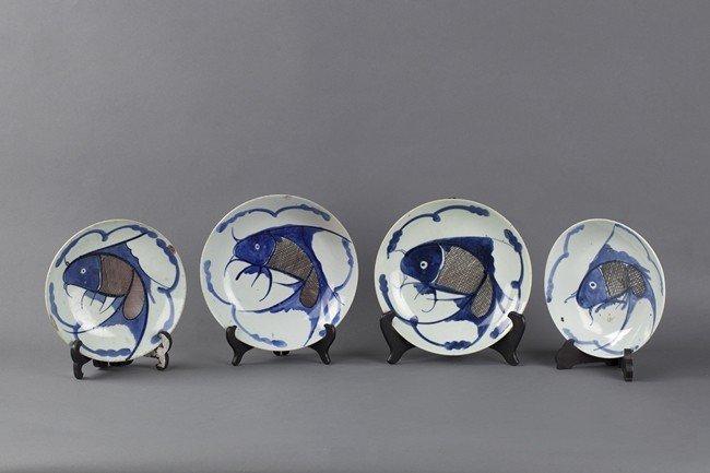 "A SET OF FOUR BLUE AND WHITE ""CARP"" PLATES"