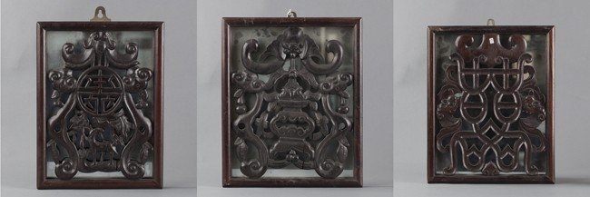 A SET OF THREE CARVED WOOD FRAMES INSET WITH MIRRORS