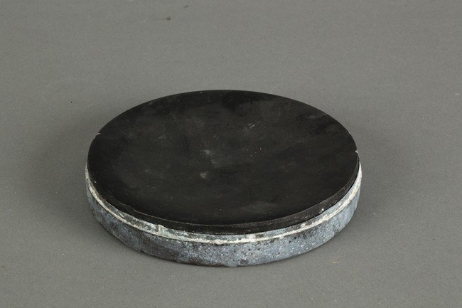 A CHINESE ROUNDED INKSTONE