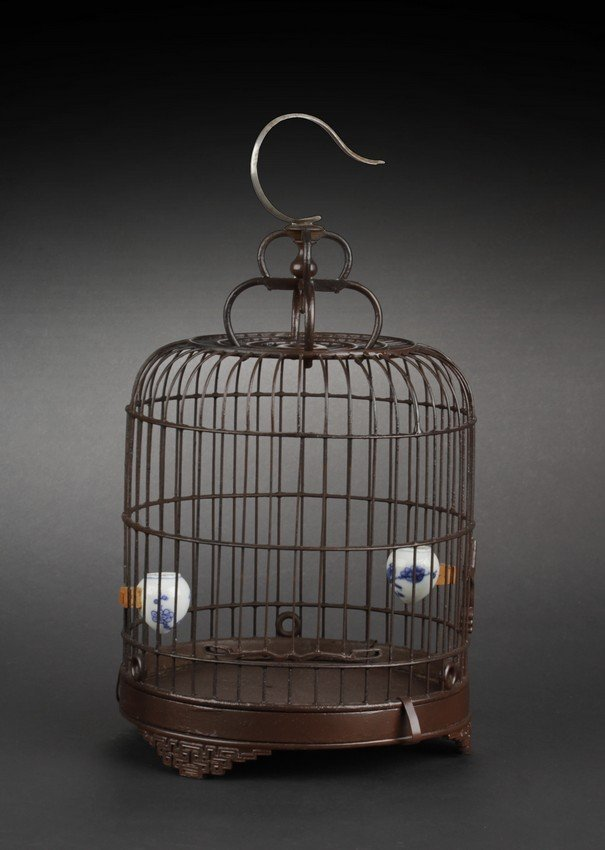 A BAMBOO BIRD CAGE WITH TWO PORCELAIN FEEDERS