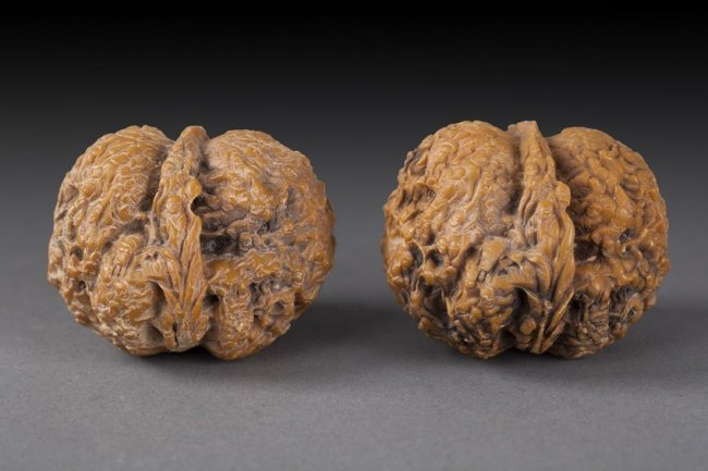 TWO ANTIQUE CARVED WALNUTS
