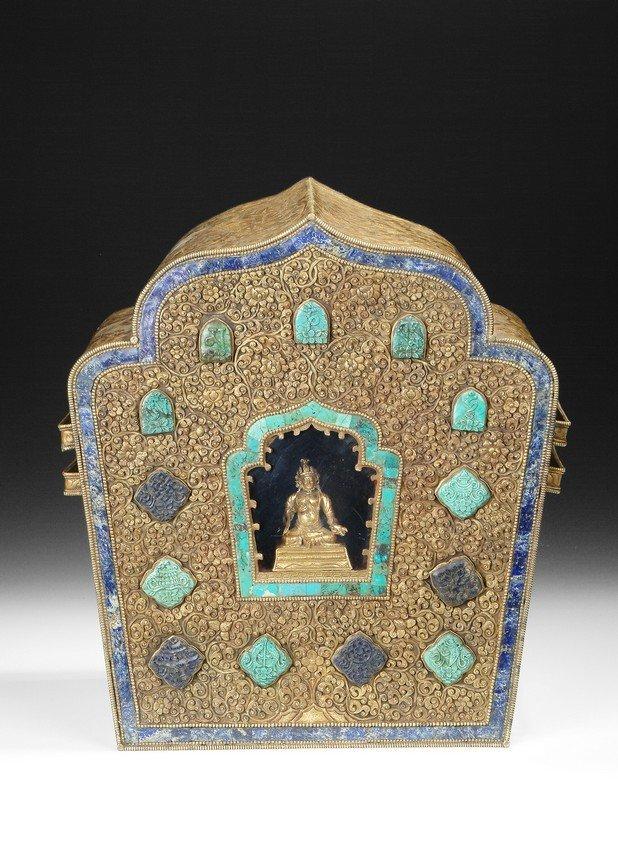 A LARGE TIBETAN DECORATED AND GILT BRONZE GAHU BOX