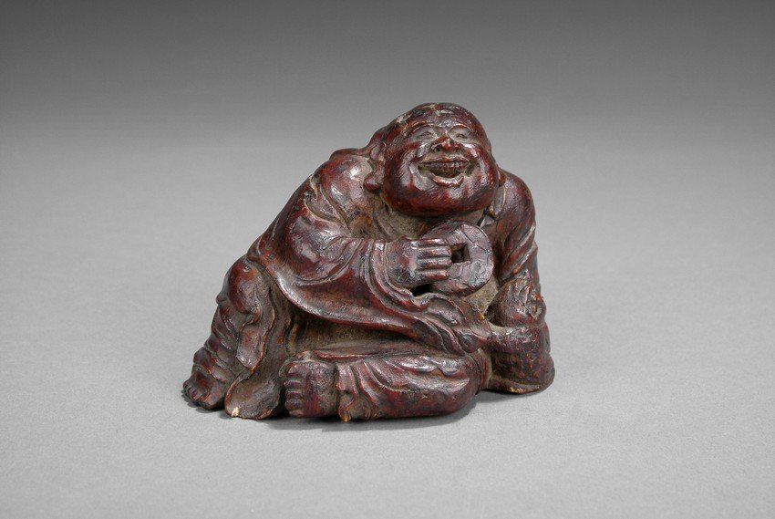 A CARVED BAMBOO FIGURE OF LIU HAI AND HIS TOAD