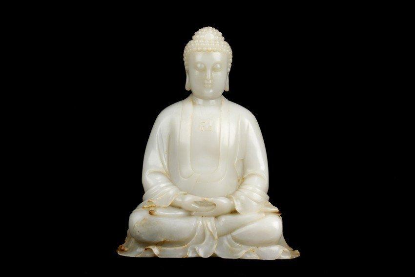 A RARE LARGE HETIAN WHITE JADE CARVED SHAKYAMUNI BUDDHA