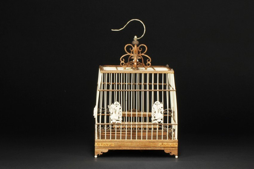 AN IVORY AND WOOD CARVED BIRD CAGE