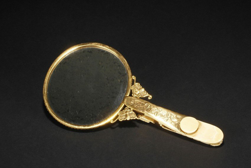 A GILT SILVER IVORY HANDLE HAND MIRROR