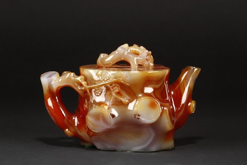 A RARE CARVED LARGE RED AGATE TEAPOT